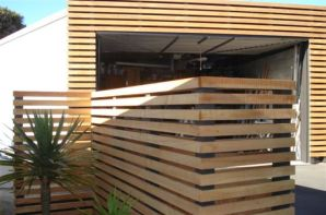 Rough sawn macrocarpa slats provides permeable screening, defines spaces, and provides a low-cost solution for cladding over potentially unattractive structures. Allowed to weather naturally to silvery-grey.