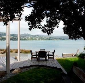 "Rustic wide macrocarpa decking provides a pleasant outdoor ""room with a view""."