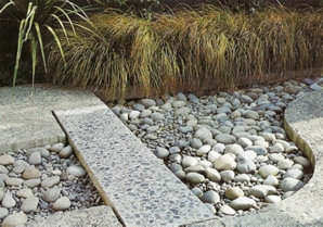 "(Designed while working at Lucas Associates). Greywacke - Canterbury Plain's building blocks used in a variety of ways juxtaposed together. Exposed aggregate concrete, polished/honed terrazzo ""bridge"", and natural loose boulder aggregate. Reminiscent of Canterbury's mighty braided rivers."